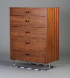 Gilbert Rohde; Black Walnut, White Holly, Bakelite and Chromed Tubular Metal Chest of Drawers for Herman Miller, c1932.