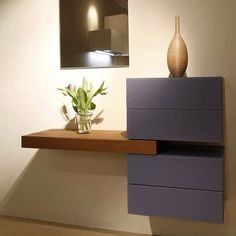 a stylish entryway floating console table made of an IKEA Besta unit and a stain...