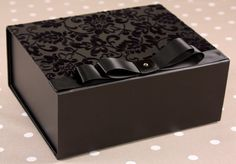 Beautiful black gift box with flock covering size 20cm x 16cm x 8cm. £8.99 Also available with satin lining £10.99