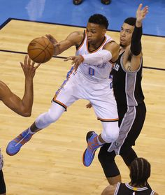 Oklahoma City's Russell Westbrook (0) passes the ball as San Antonio's Danny Green (14) defends during Game 4 of the Western Conference semifinals between the Oklahoma City Thunder and the San Antonio Spurs in the NBA playoffs at Chesapeake Energy Arena in Oklahoma City, Sunday, May 8, 2016. Photo by Sarah Phipps, The Oklahoman