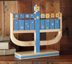 a wooden menorah that rotates btwn flames and numbers? love....someday, for the children