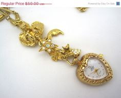 Vintage Kirks Folly Necklace - Charm Watch Jewelry - Hearts and Cherub