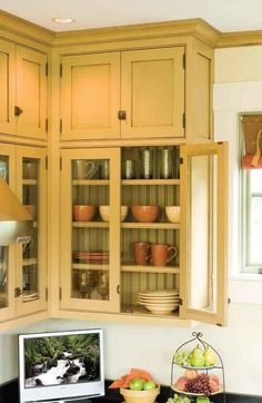 Is it a farmhouse kitchen, a 19th-century butler's pantry, or a Colonial Revival interpretation? Hard to tell, because the layout, materials, and finishes in