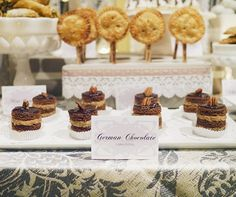 German chocolate cake bites topped with pecans are a beautiful addition to this wedding dessert table.