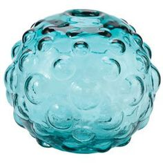 """Craft a chic vignette in your living room, foyer, or den with this eye-catching design, masterfully crafted for tempting style and lasting appeal.      Product: Vase  Construction Material: Glass  Color: Aqua      Dimensions:  5"""" H x 5"""" Diameter"""