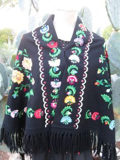 Check out this item in my Etsy shop https://www.etsy.com/listing/251912434/vintage-hand-embroidered-black-wool