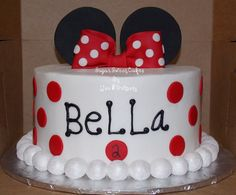"Red & White Minnie Mouse - 3 layer, 8"" buttercream cake w/fondant decorations. Bow & ears were hand made out of fondant. The border was pearlized with pearl dust. TFL!"