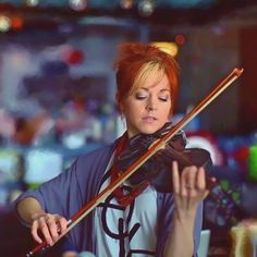 It is really scary how much Lindsey Stirling looks like my Aunt Kate! I bet if you put them next to each other, people would think they're violin playing twins!!!!