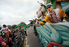 Throw Me Something, Mister! - A mystery rider tosses beads as the Krewe of Endymion 2013 rolls down their traditional Mid-City route in New Orleans, Louisiana (photo by Michael DeMocker, Nola.com | The Times-Picayune)