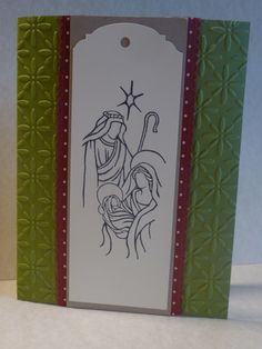 Handmade with Stampin'Up products including the set Holy Triptych and tag topper with ribbon matt. Texture impressions folder pulls the card together for a calm and gentle Christmas card.