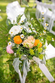 Orange floral aisle arrangements