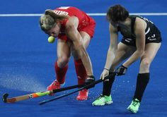 Crista Cullen (left) of Great Britain is struck in the face by the ball after…