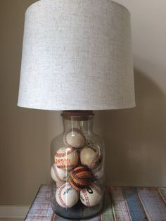 Clear lamp base filled with baseballs! Lamp can be found at Marshall's, TJ Maxx and Home Goods.