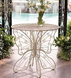 For inside or out to show lupus support:  Very delicate looking!  Metal Butterfly Table | Wind and Weather