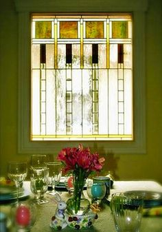 10 Stained Glass Windows We Love-  Private Dining    A stained glass window gives this dining room some privacy from the outside world, all the while projecting a warm glow on its occupants.