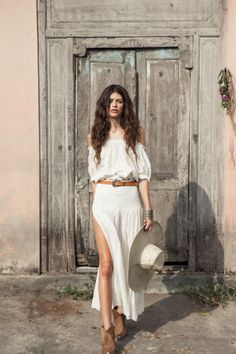 white outfit with cowboy boots