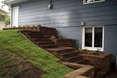 A formerly unusable slope has been transformed into a walkway between the back door and a lower patio. Product used: Standard