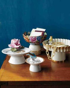 It's not just cake that deserves to be put on a pedestal. Using dishes you already own and flea market finds, you can build footed dishes in various styles that rise to many different occasions.To create a whimsical granny-chic pedestal stand, glue a tchotchke to a gold-trimmed or floral-patterned dish, and then affix that dish to an upside-down teacup or bowl. A largely white palette will keep the pedestals -- used here for keys, jewelry, or mail -- from looking kitschy.