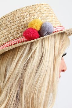 """Pom Straw Boater Hat. This summer time straw  hat  features a boater style design, structure round brim, braid trim accent with pom poms, and inner ribbon lining.100% Grass.Measurement Brim measure approx. 1.5""""Crown height measure approx. 3.5"""""""
