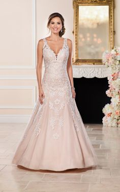 Drawing inspiration from a classic silhouette and fresh lace, this modern A-line with illusion keyhole back from Stella York is the perfect lace gown.