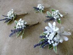 Buttonholes of gypsophila and lavender with additional agapanthus in the Groom's buttonhole.