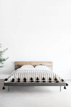 Moroccan Pom Pom Blankets: The On Trend Decor Item We're Seeing Everywhere | Throw blankets bring small touches of style without feeling overwhelming. Introduce pattern, texture, color and more with a pom pom throw blanket in any room of the house.