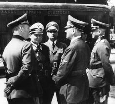 Adolf Hitler with his generals at Compiegne during the French capitulation. From left to right: Wilhelm Keitel, Hermann Göring, Rudolf Hess, Hitler, Erich Raeder and Walther von Brauchitsch.  The railcar behind the group is the same one used by the French during the First World War when they accepted Germany's unconditional surrender.  Hitler neither forgot nor forgave insults to the Fatherland.