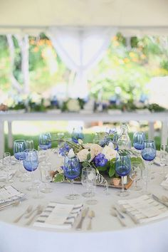 blue and cream wedding decor for a seaside wedding  http://www.weddingchicks.com/2013/12/11/seaside-wedding-2/