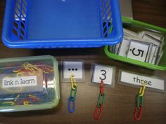 punch holes in number cards to add links  Mrs. Bremer's Kindergarten: Math Work Stations: Get them for free!