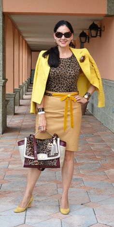 Susana Fernandez | A Key to the Armoire  / leopard print / yellow /tan leather skirt / Ralph Lauren / Coach / ocelot print / animal print / antique ivory cuffs / Lea Stein Paris brooch / Jord Watch / wood watch / Saks Fifth Avenue Black / leather pencil skirt / ribbon belt / J Crew / Ann Taylor / yellow pumps / work attire / office attire / tortoise