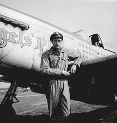 """Lt. Col. Bruce W. Carr, Union Springs, NY, stands by """"Angels Playmate"""", he had claimed 22½ aerial victories by the end of WWII."""