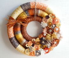 Wrapped Triple Wreath in fabric, yarn and burlap. Handmade fabric and felt flowers. Made by Wreaths By Emma Ruth. Perfect for your fall decor.