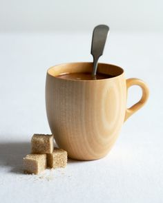 I am a linden wood mug. I'll stand out from the rest of the cups in your pantry. My unique natural wood grain will find a way into your heart to become your new favorite coffee mug. Or any hot drink, for that matter.