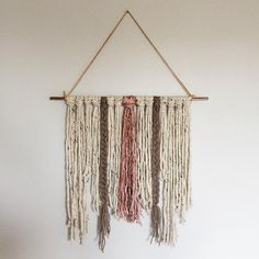 This #wallhanging is one of my favorites. I love neutrals so the mix of brown, dusty pinks and cream is spot on. You can find this piece (and some other friends) in the shop next week! #yarn #yarnhanging #bohobaby #bohonursery #handmade #braidedwallhanging #bohodecor #boholiving #etsyshop #makersvillage #craftsposure