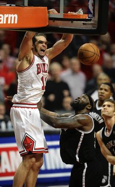 Chicago Bulls center Joakim Noah makes a dunk over Brooklyn Nets power  forward Reggie Evans late in the second overtime in Game 4 of an Eastern  Conference ... 964b50fc1