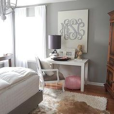 Amazing bedroom with grey walls, West Elm parsons Desk in Glossy White, pink leather Moroccan leather pouf, mercury glass lamp, brown cowhide rug layered over cream flokati rug and Etsy Southern Nest Wooden Monogram. Home Bedroom, Bedroom Decor, Bedrooms, Master Bedroom, Gray Bedroom, Bedroom Ideas, Bedroom Lamps, Bedroom Office, Teen Bedroom