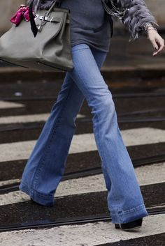 For a long lean look pair a medium wash flare jean with a chunkier heel. Add a longer tee or sweater and viola! You are instantly elongated.