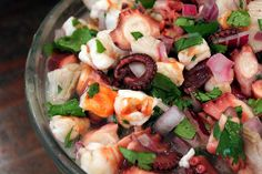 "Delicious Shrimp and Octopus Ceviche I This is a dish where raw fish is ""cooked"" in citrus juice. It's a wonderful dish served as a #salad tossed with avocado, cilantro and chopped tomato. #Fish&SeafoodRecipes"
