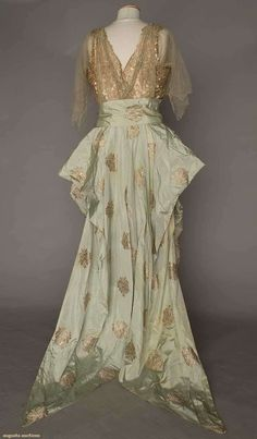 Balcom New York Ball Gown, 1910s Gold lame fabric with pastel blue silk; lame lace bodice with pearls and rhinestones (back view)