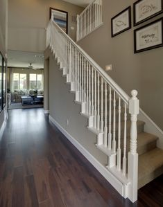 White banister, painted banister, white staircase, wood railings for stairs White Banister, White Staircase, Staircase Railings, Wood Stairs, Banisters, Staircase Design, Banister Ideas, Concrete Stairs, Painted Stair Railings