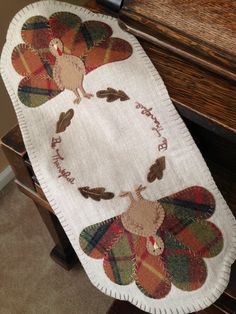 Wool appliqué. Hand stitched by Mary Ann Thom. Gobble Gobble by Pretty Penny Precuts.