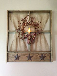 Tobacco wood window with candle and wreath. Designed by Farm Wives Collections. FarmWivesCollections.etsy.com