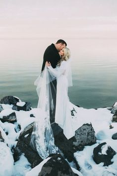 A snowy seascape wedding photo. Simply Stunning.