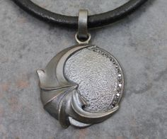 """Moonshine"", Midnite Collection by Gary Ewing. Blackened (oxydized) sterling silver with black diamonds. ""Heart of the Moon, pulse of the tides. Endless desire flowing inside."""