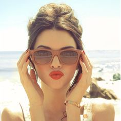 nude sunglasses, red lipstick, and a beautiful glow!