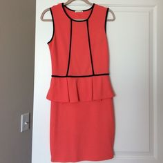 Coral and Black Peplum Dress Super flattering peplum party dress by Soprano. 75% polyester 25% rayon. Edgy black piping makes for some gorgeous curves. Love this dress! Soprano Dresses