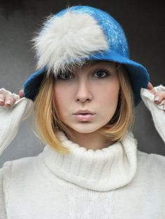 Handfelted wool hat with fur. The hat is felted from finest wool, it is wonderfully soft and will keep you warm on the cool days to come. All the