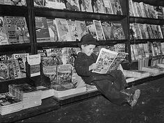 vintage photo of a 1942 newsstand—the young reader having made the wise choice of an issue of CAPTAIN AMERICA COMICS.
