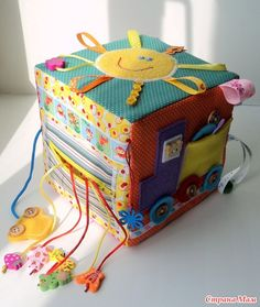 (Russian site) Just great pictures for ideas for an activity cube or quiet book. Baby Sewing Projects, Sewing For Kids, Diy For Kids, Baby Quiet Book, Felt Quiet Books, Baby Sensory, Sensory Toys, Cube Bebe, Baby Cubes