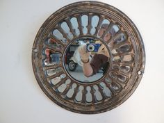 This mirror is made with household iron from the 1800's.  Love this Etsy store where this artist takes antique iron and makes beautiful and interesting pieces for the home with them.